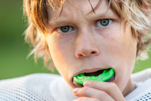 teen football player with mouthguard
