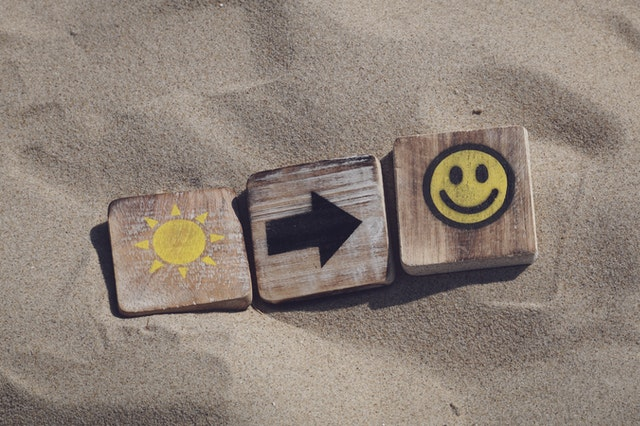 happy sun blocks in sand