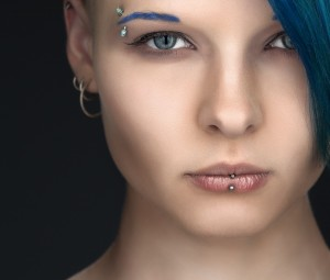 young woman with facial piercing
