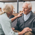 woman comforts man with dementia